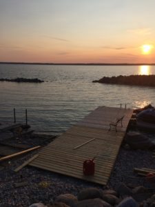 Sunset over lake with dock construction and harbour
