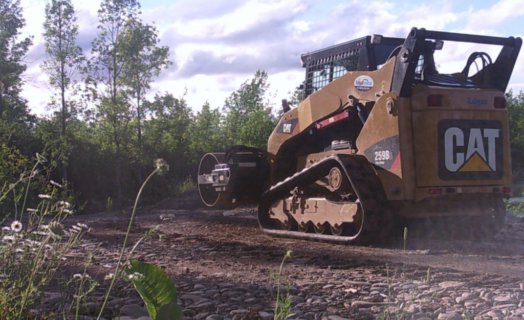 Skidsteer with roller working on laneway
