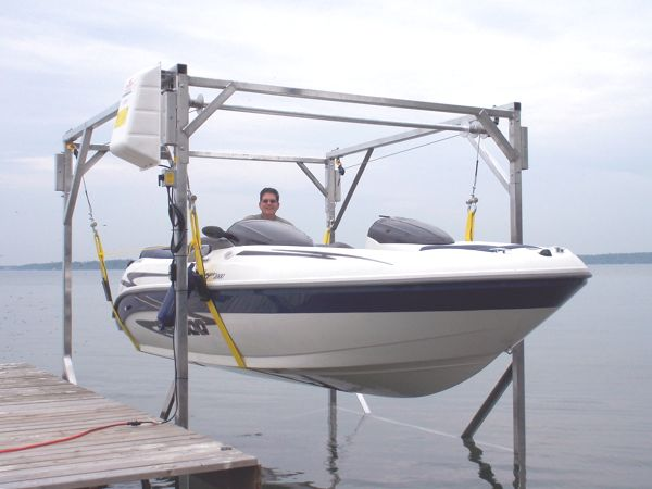 Portable boat lift with boat and man inside