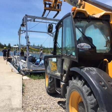 Installation of boat lift with Edgar Excavation tractor