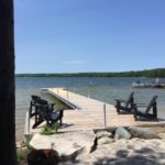 Naylor docking system with chairs and waterfront view